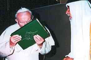 Pope John Paul kissing the Quran