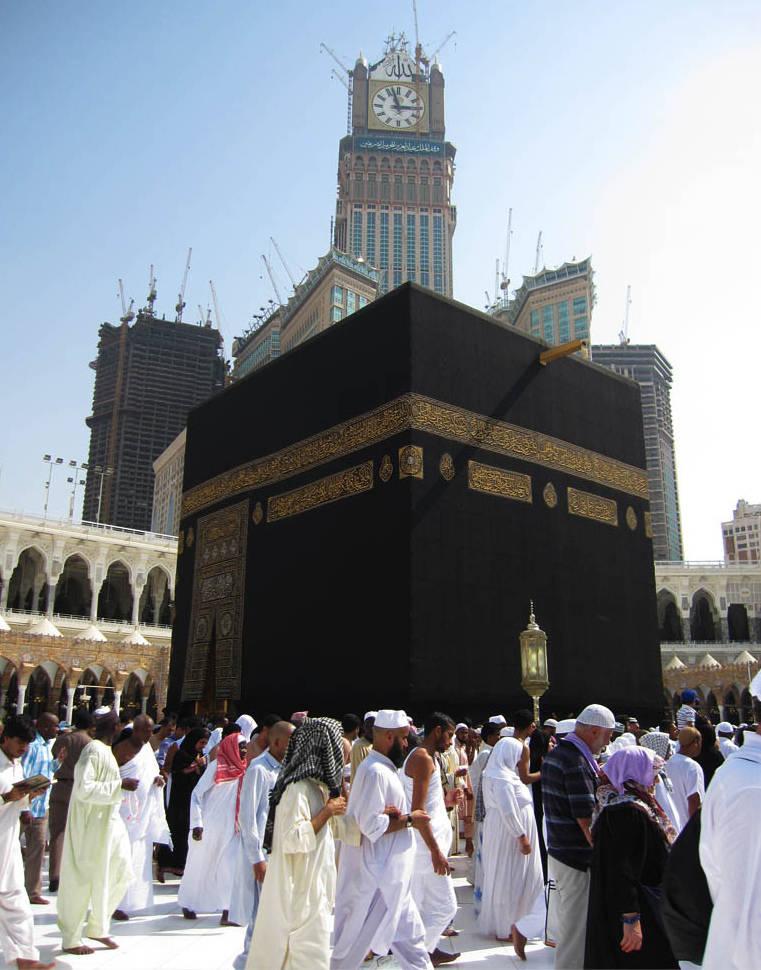 Mecca clock tower behind black stone shrine